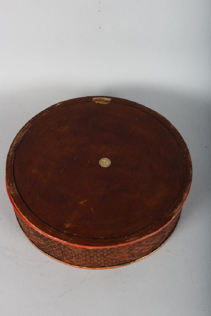 A CIRCULAR RED LACQUER BOX AND COVER. 11ins diameter. - 2