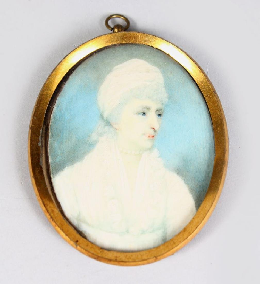 AN OVAL MINIATURE OF A LADY in white dress and bonnet.