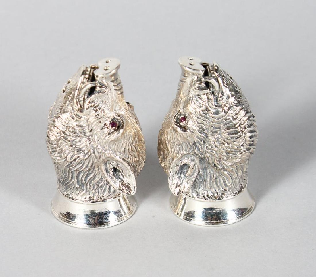 A GOOD PAIR OF SILVER BOAR'S HEAD SALT AND PEPPERS with