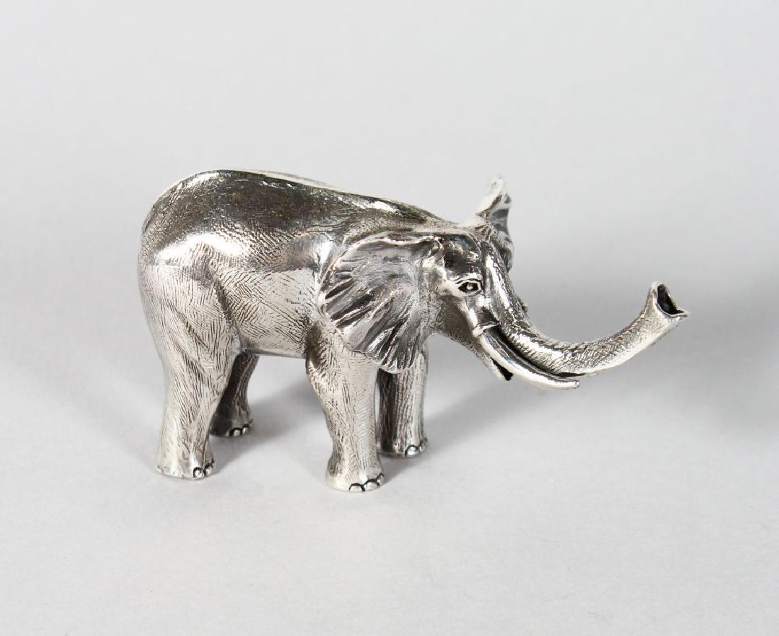 A SILVER NOVELTY ELEPHANT.