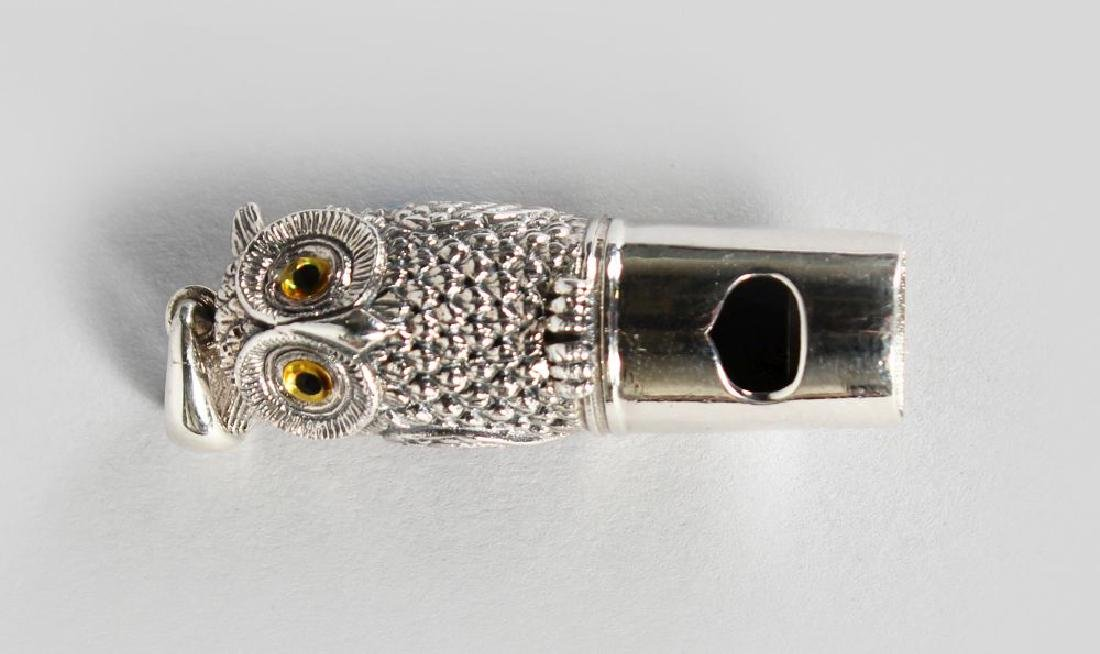 A NOVELTY SILVER OWL WHISTLE.