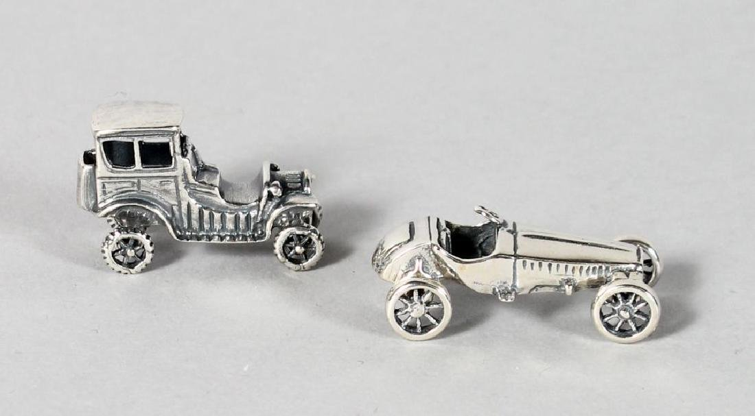 TWO NOVELTY SILVER CARS.