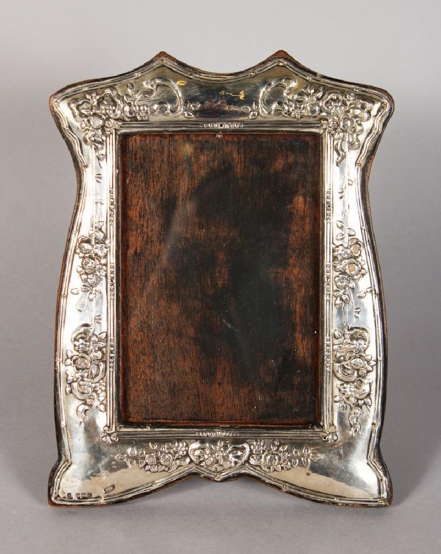 A SILVER PHOTOGRAPH FRAME, repousse with roses.