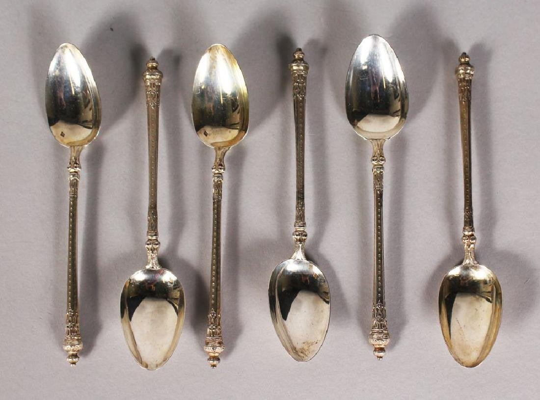 A SET OF SIX SILVER ENGRAVED TEASPOONS.