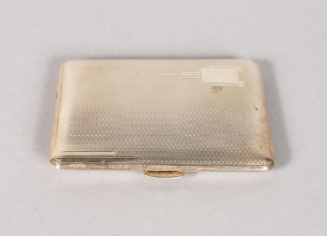 AN ENGINE TURNED CIGARETTE CASE.  Birmingham 1937.