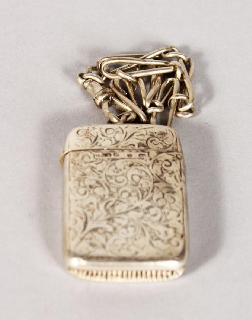 A VICTORIAN ENGRAVED SILVER VESTA CASE and CHAIN.