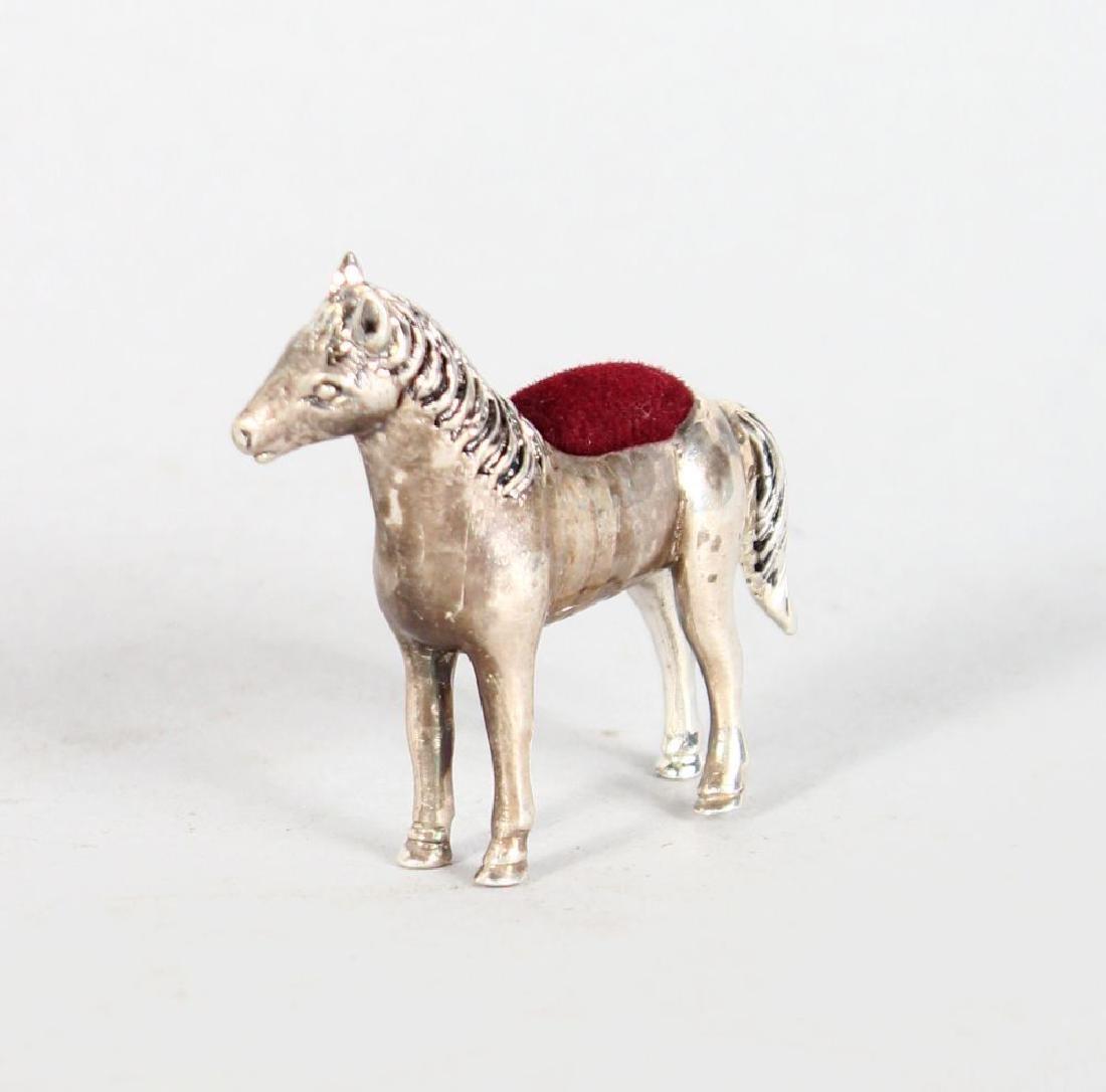 A SILVER NOVELTY HORSE PIN CUSHION.