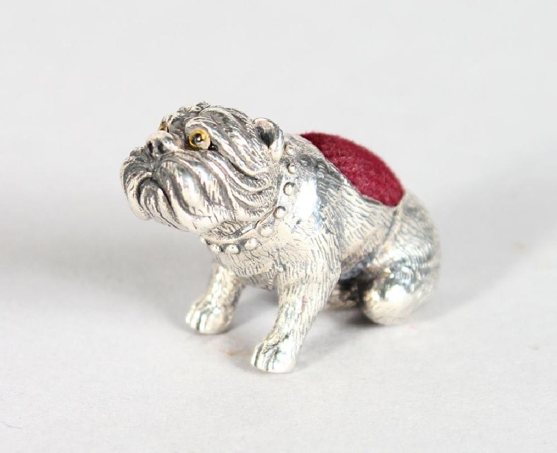 A SILVER NOVELTY BULL DOG PIN CUSHION.