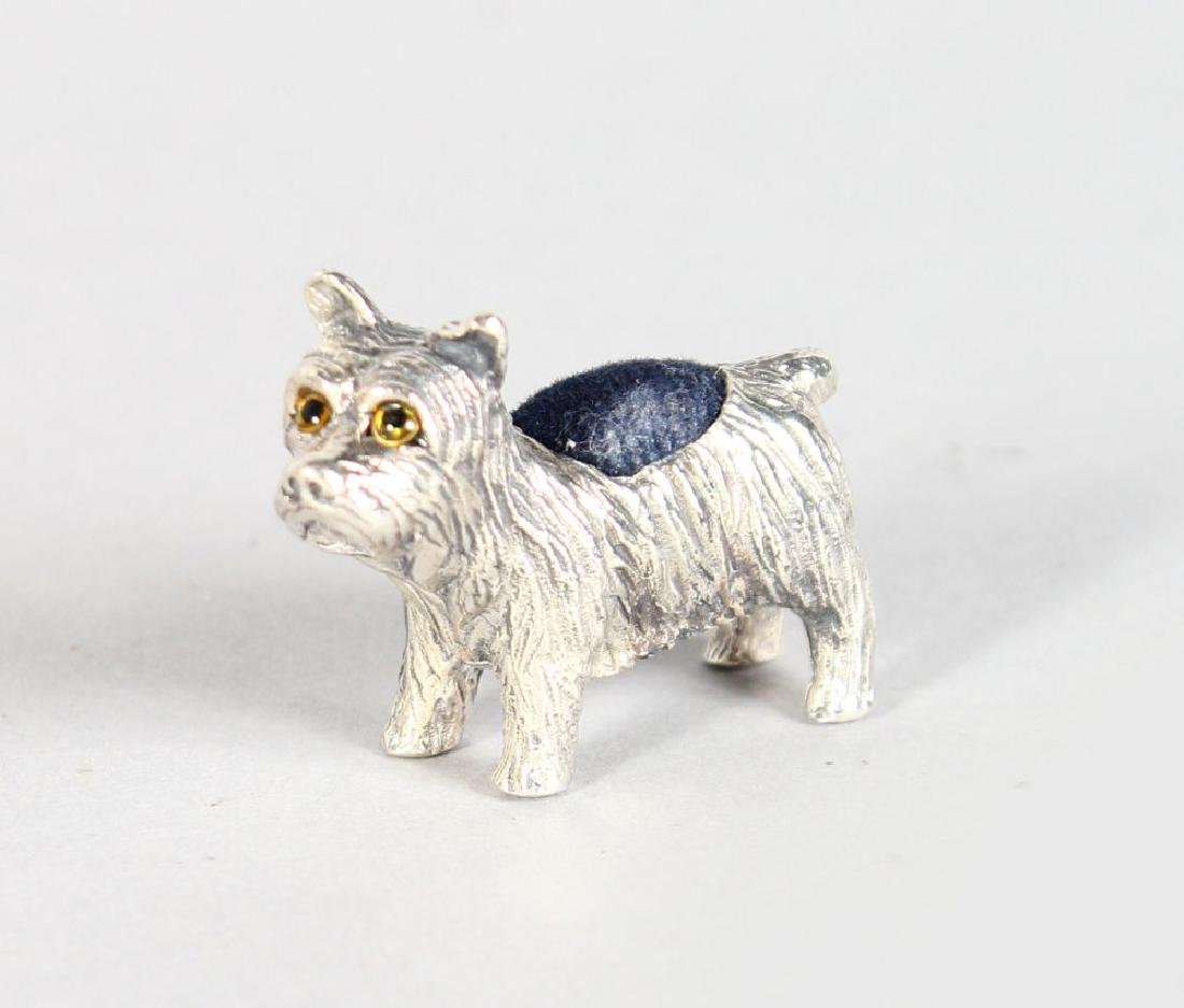 A SILVER NOVELTY TERRIER PIN CUSHION.