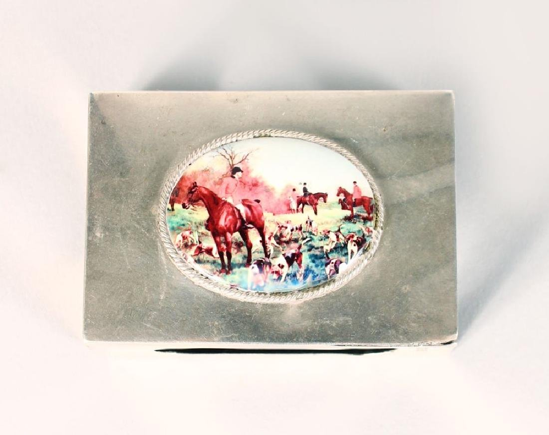 A SILVER MATCH CASE HOLDER, LONDON 1919, with an enamel