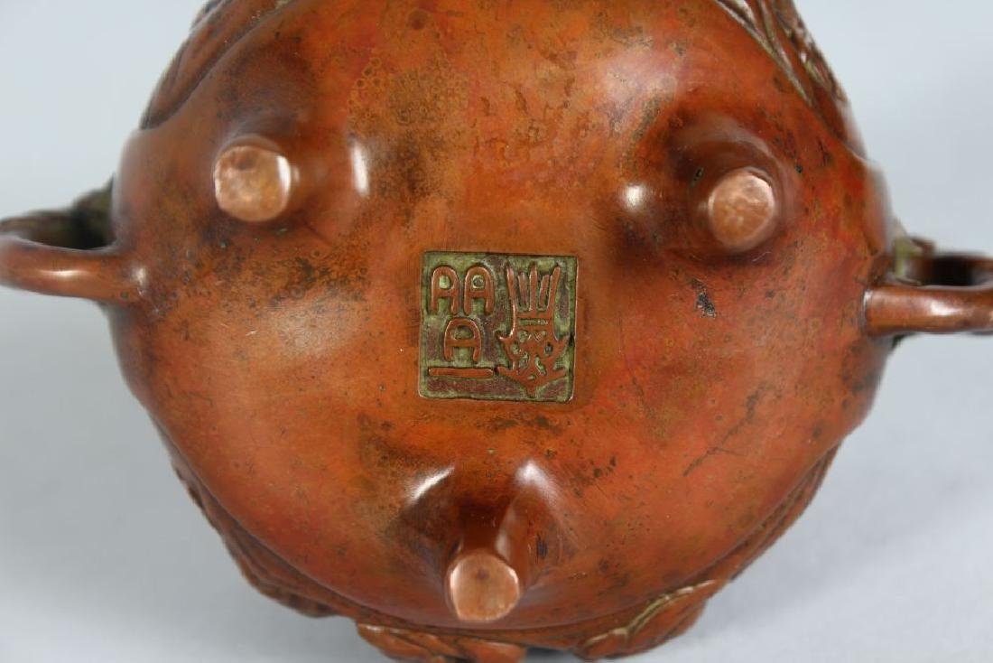 A SMALL CHINESE BRONZE CENSER, on three feet.  4ins - 2