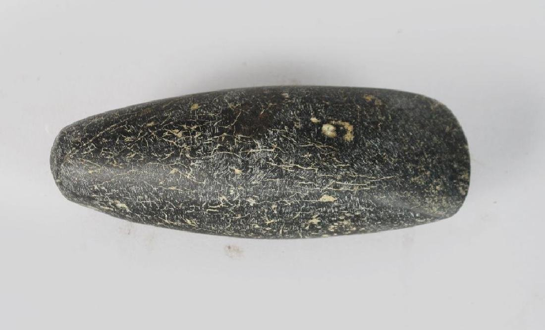 A NEOTHLITHIC AXE HEAD. 4ins long.
