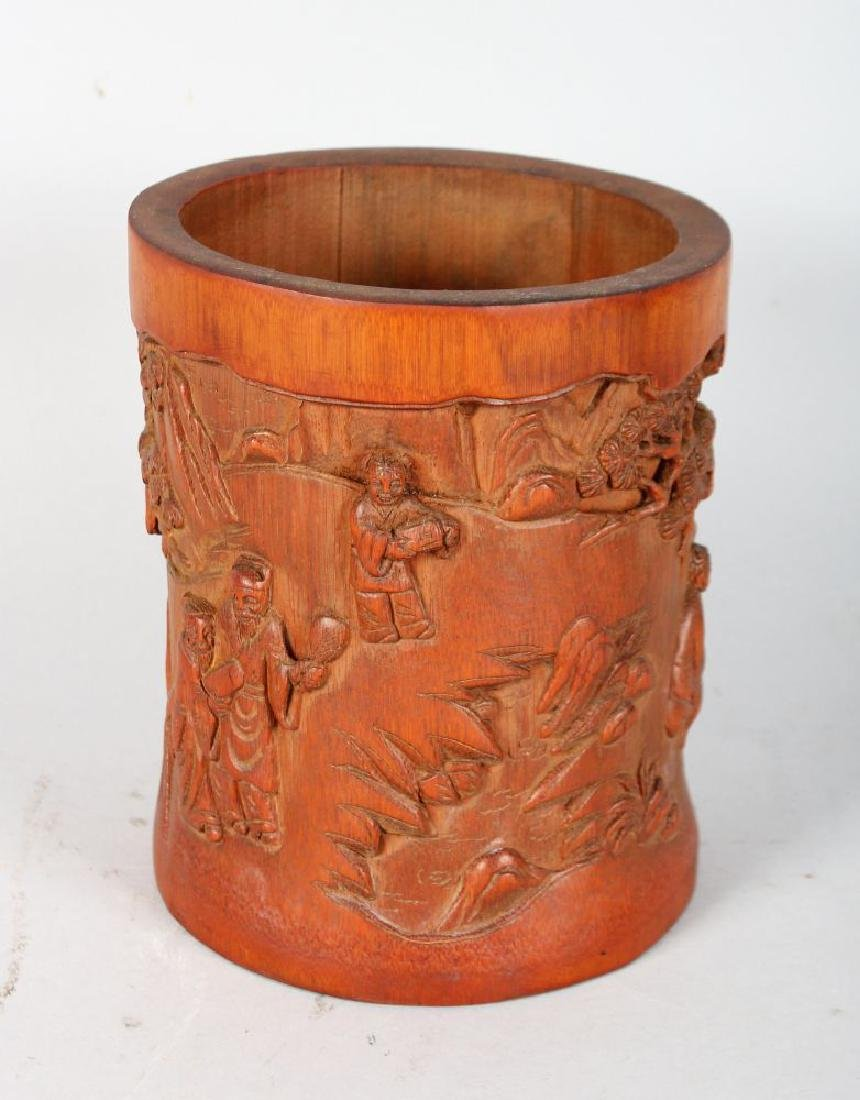 A CHINESE CARVED BAMBOO BRUSH POT.  7ins high.