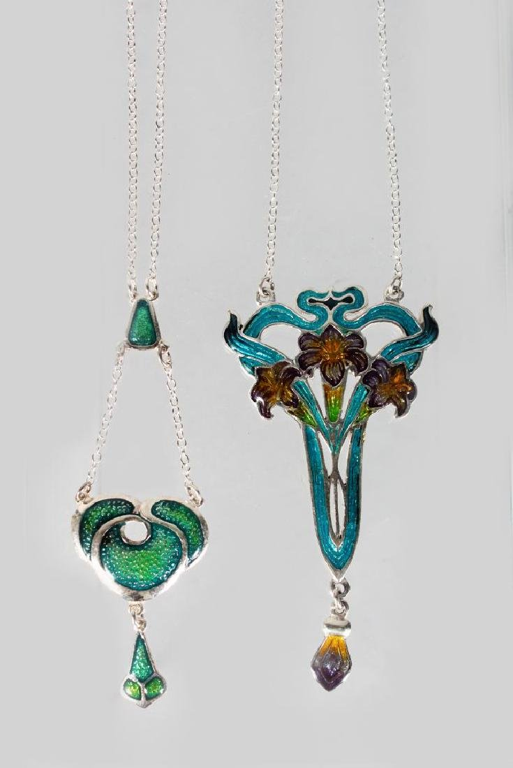 TWO SILVER AND ENAMEL PENDANTS AND CHAINS.