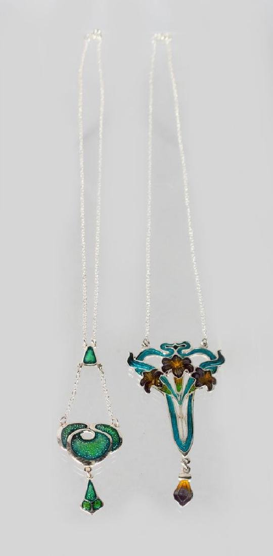 TWO SILVER AND ENAMEL PENDANTS AND CHAINS. - 2