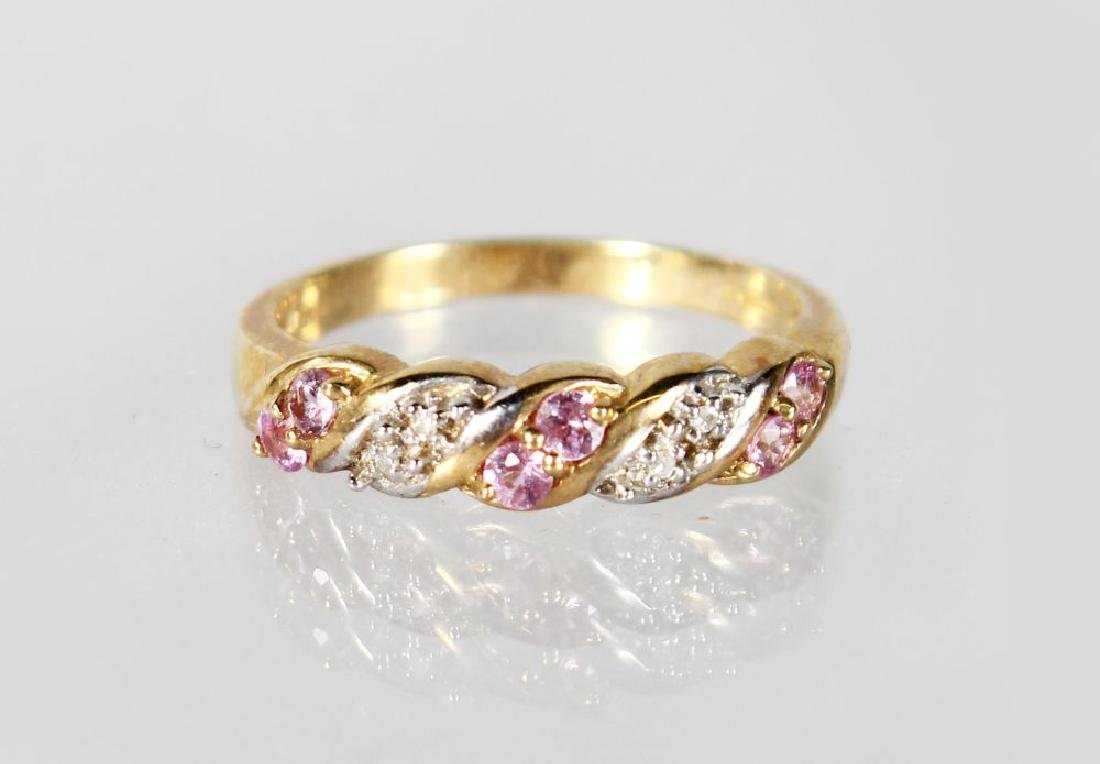 A 9CT GOLD, PINK SAPPHIRE AND DIAMOND RING.