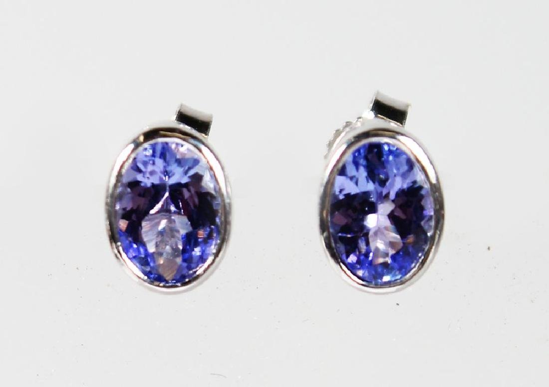 A PAIR OF 9CT WHITE GOLD AND TANZANITE EARRINGS.