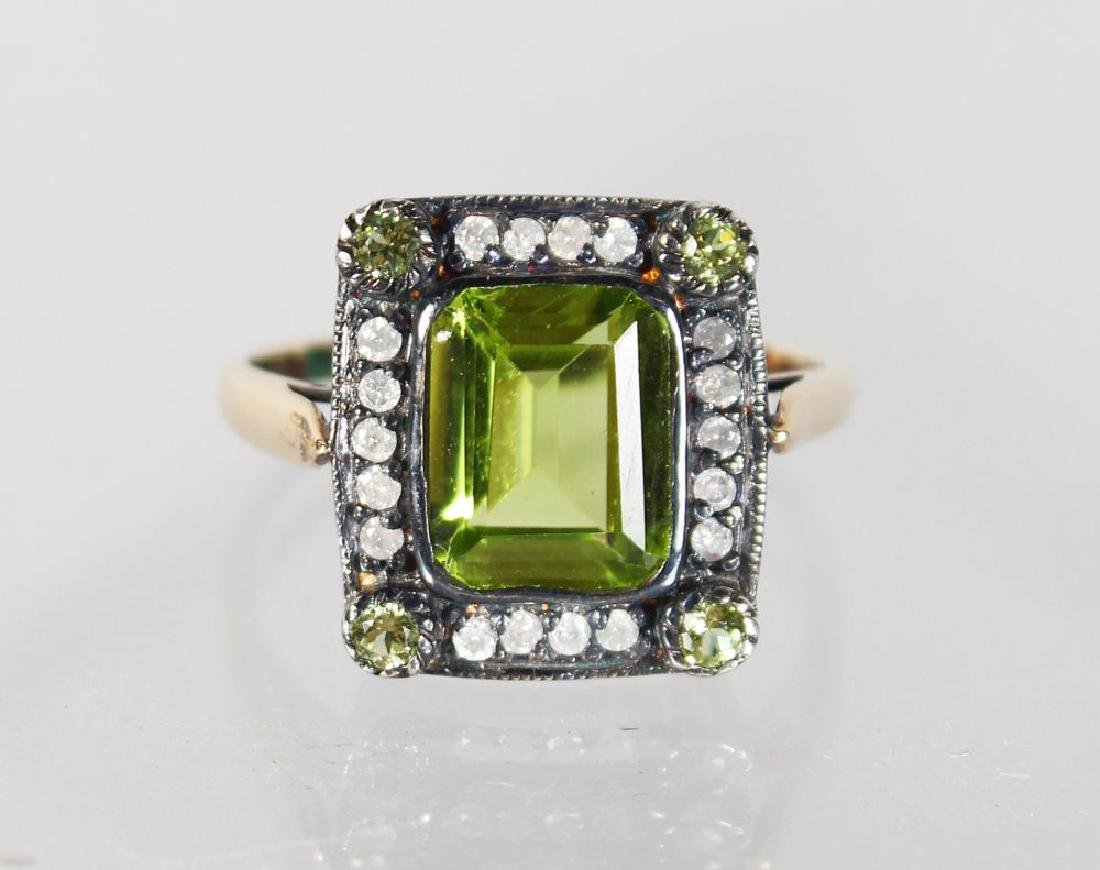 A 15CT GOLD AND SILVER PERIDOT AND DIAMOND RING.