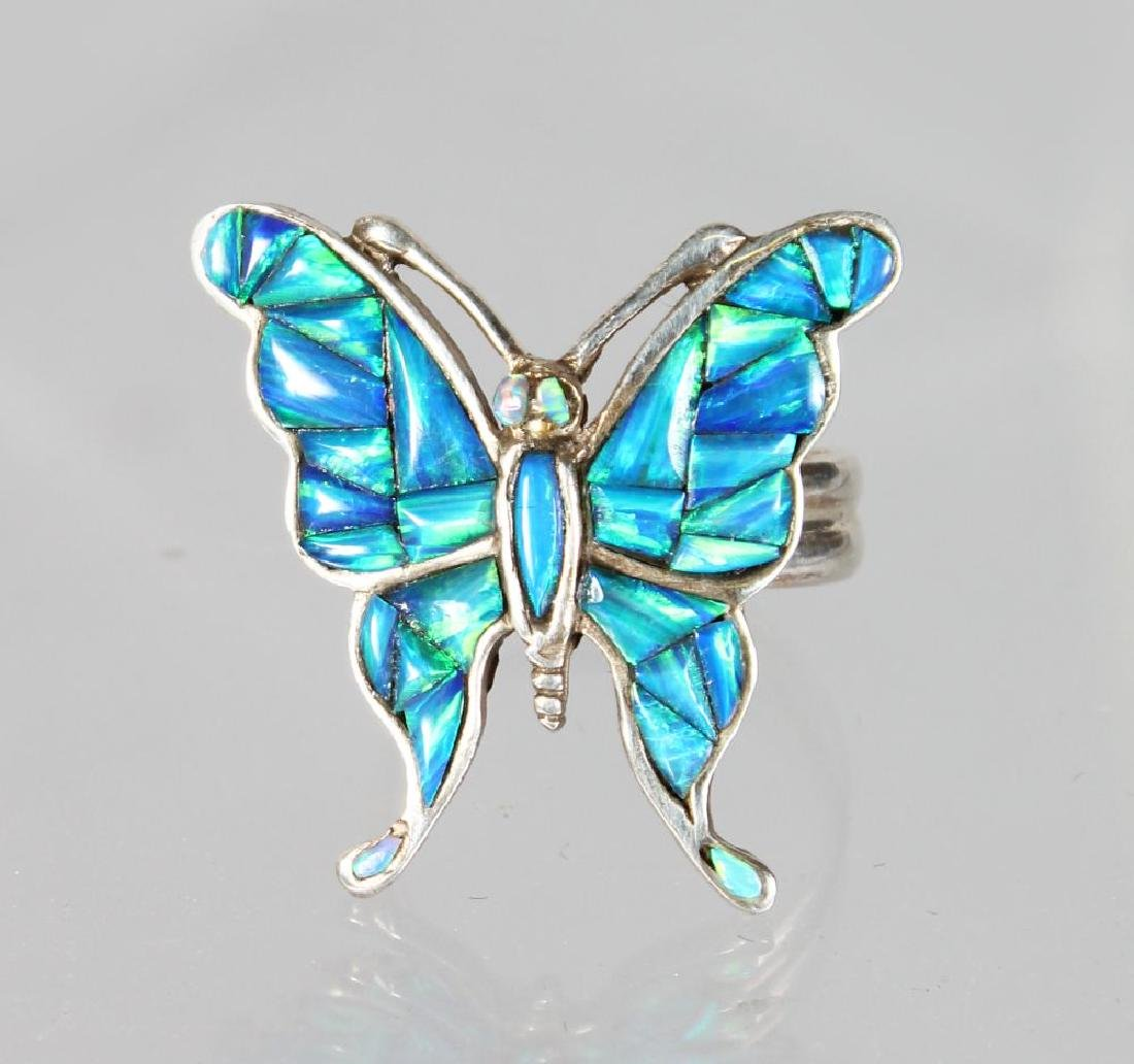 A SILVER AND REAL OPAL BUTTERFLY RING.