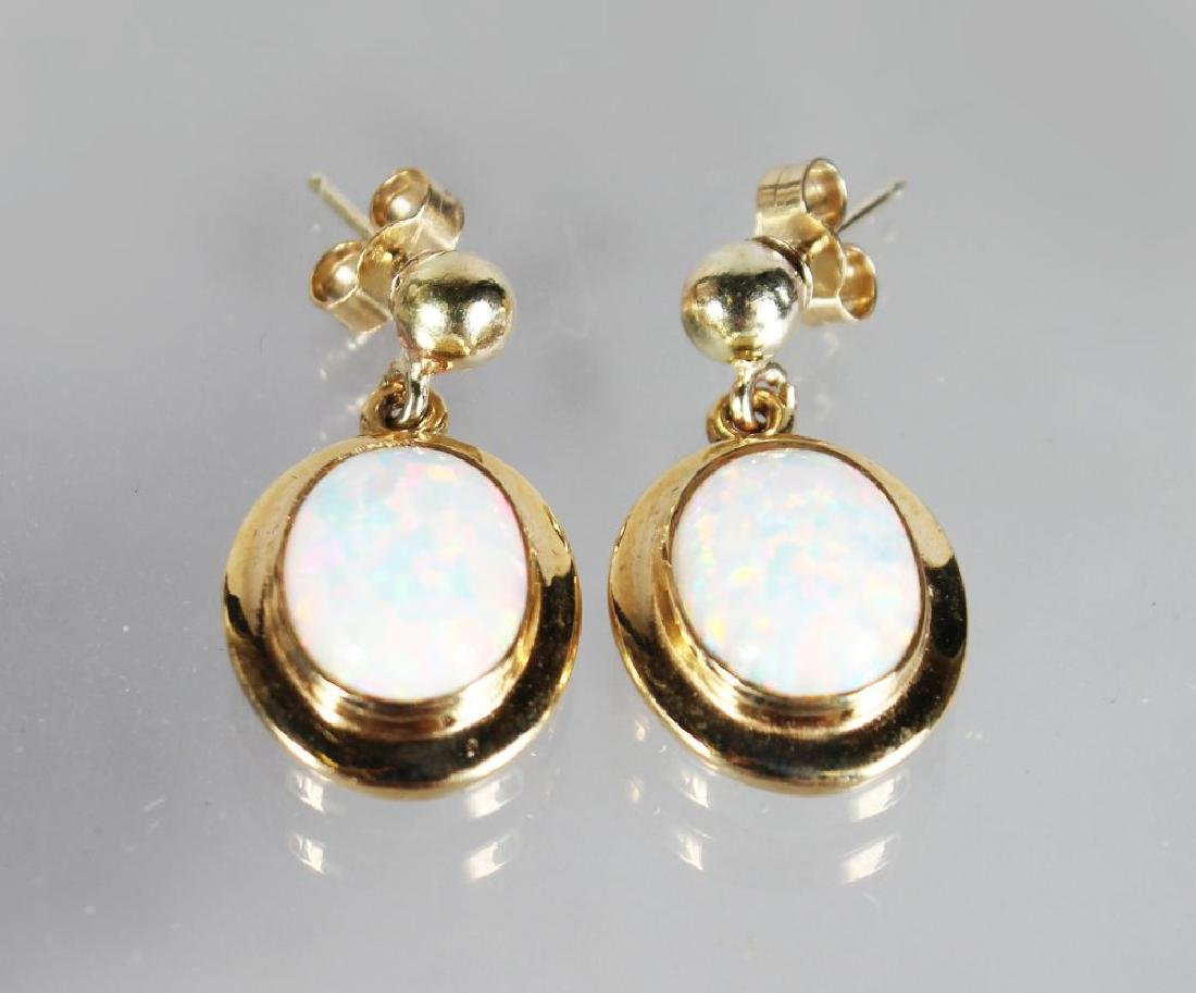 A PAIR OF 9ct GOLD GILSON OPAL DROP EARRINGS.