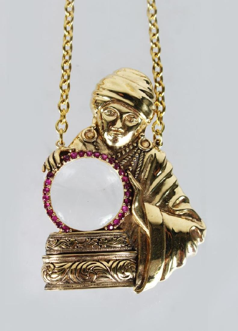 AN 18ct GOLD PLATED MYSTICAL LADY SPY NECKLACE.