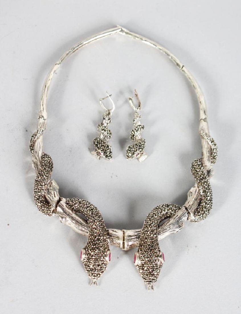 A SILVER MARCASITE SET OF SNAKE NECKLACE AND EARRINGS.