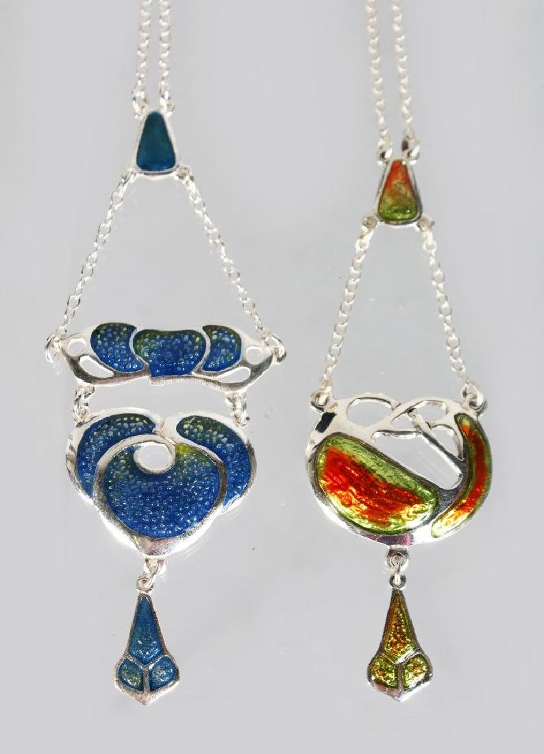 TWO SILVER AND ENAMEL ART DECO STYLE PENDANTS AND