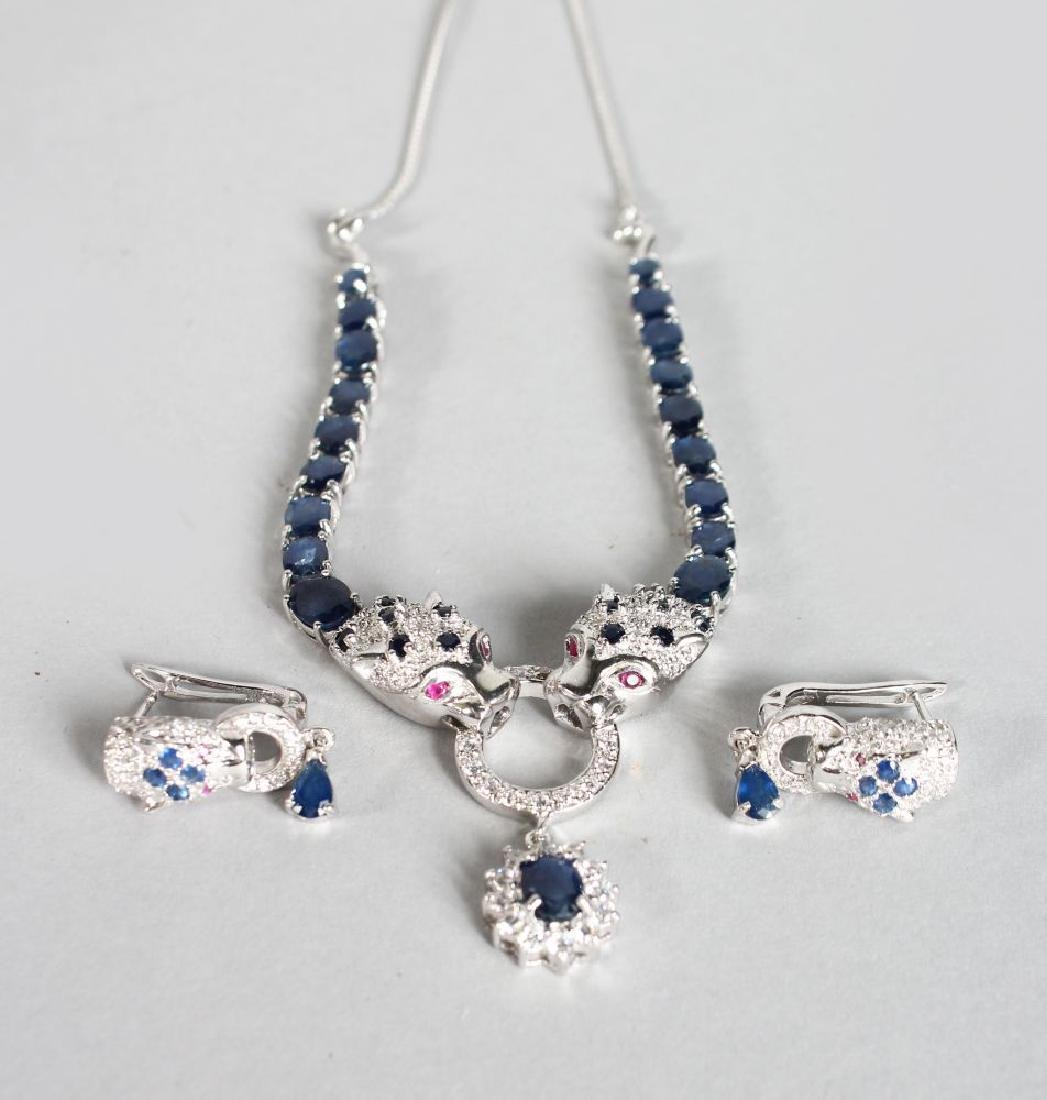 A SILVER SAPPHIRE AND RUBY PANTHER NECKLACE AND