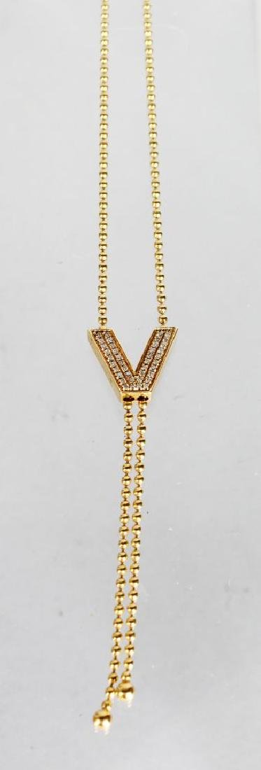 "AN 18ct GOLD AND DIAMOND ""vERSACE"" STYLE NECKLACE."