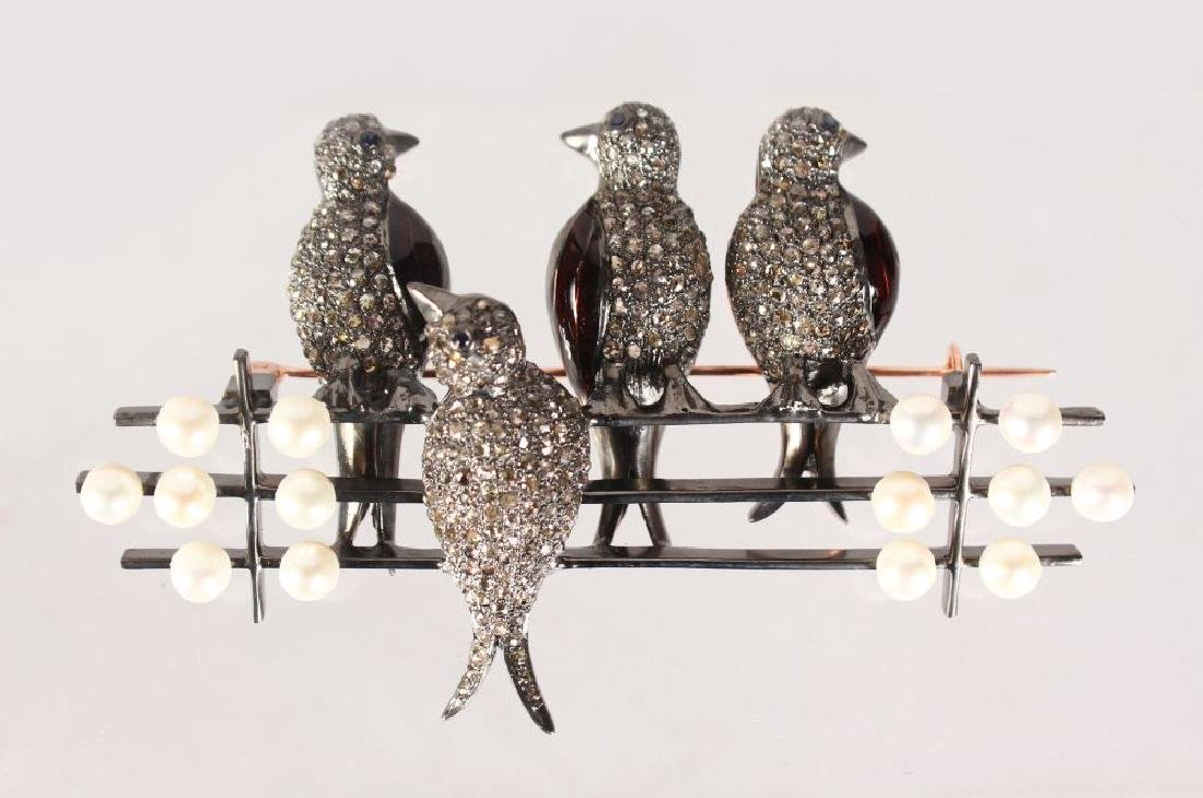 A GOOD GOLD AND SILVER BROOCH, FOUR BIRDS ON A FENCE,