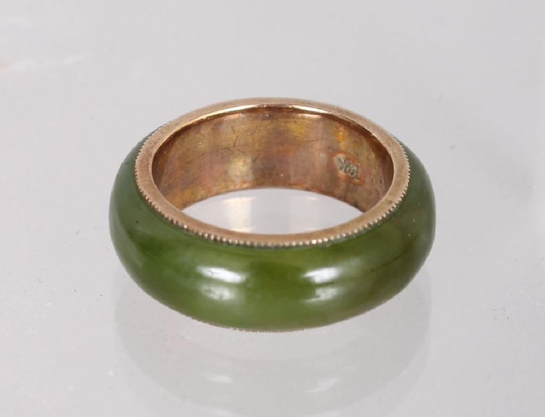 AN 18CT YELLOW GOLD AND JADE WEDDING BAND.