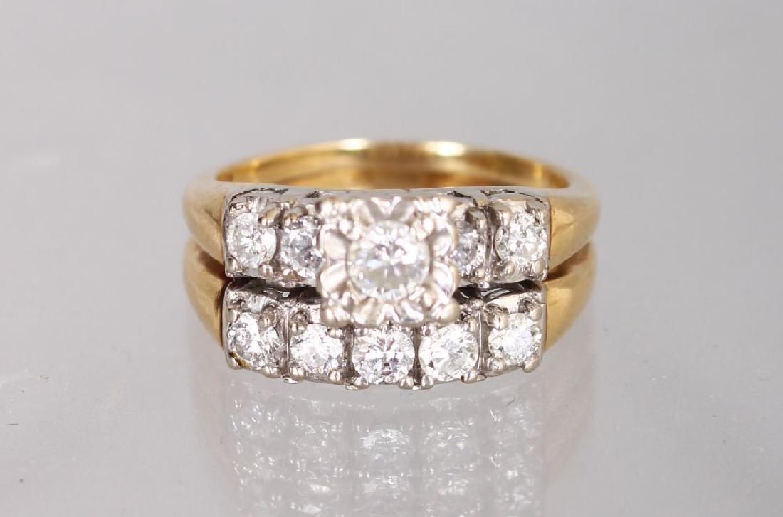 AN UNUSUAL 14K YELLOW GOLD AND DIAMOND SET DOUBLE ROW