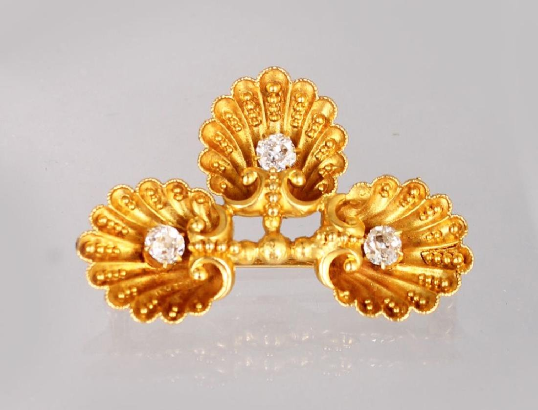 AN UNUSUAL GOLD AND DIAMOND BROOCH, modelled as three