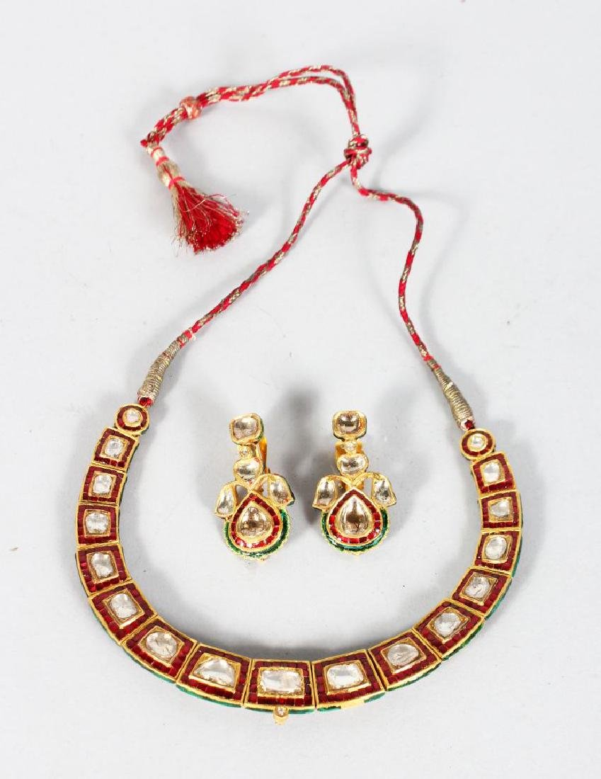 A SUPERB DIAMOND AND RUBY ENAMEL BACK GOLD NECKLACE and