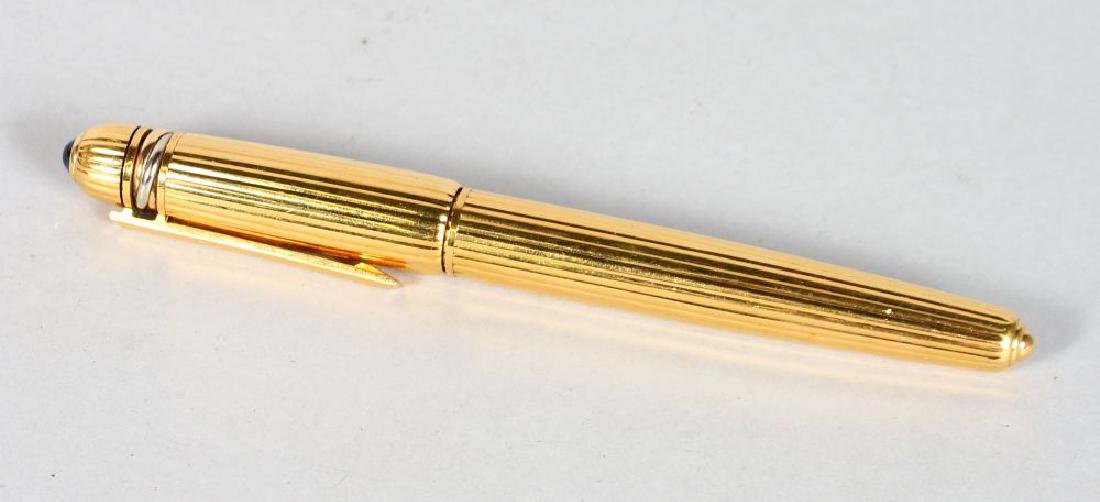 A VERY GOOD CARTIER PEN in a red pouch.