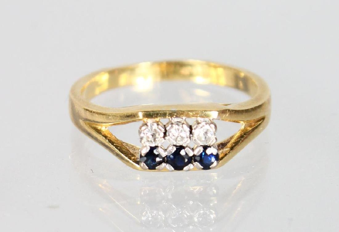 AN 18CT GOLD, DIAMOND AND SAPPHIRE RING.