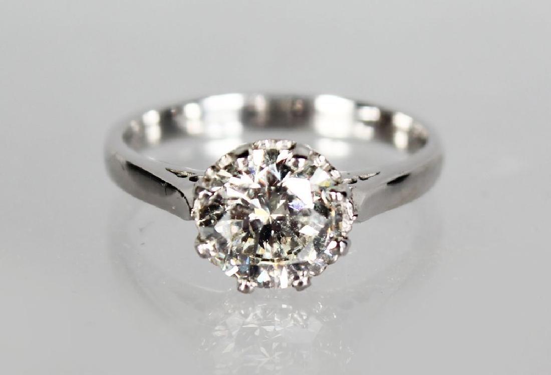 AN 18CT WHITE GOLD SINGLE STONE DIAMOND RING OF