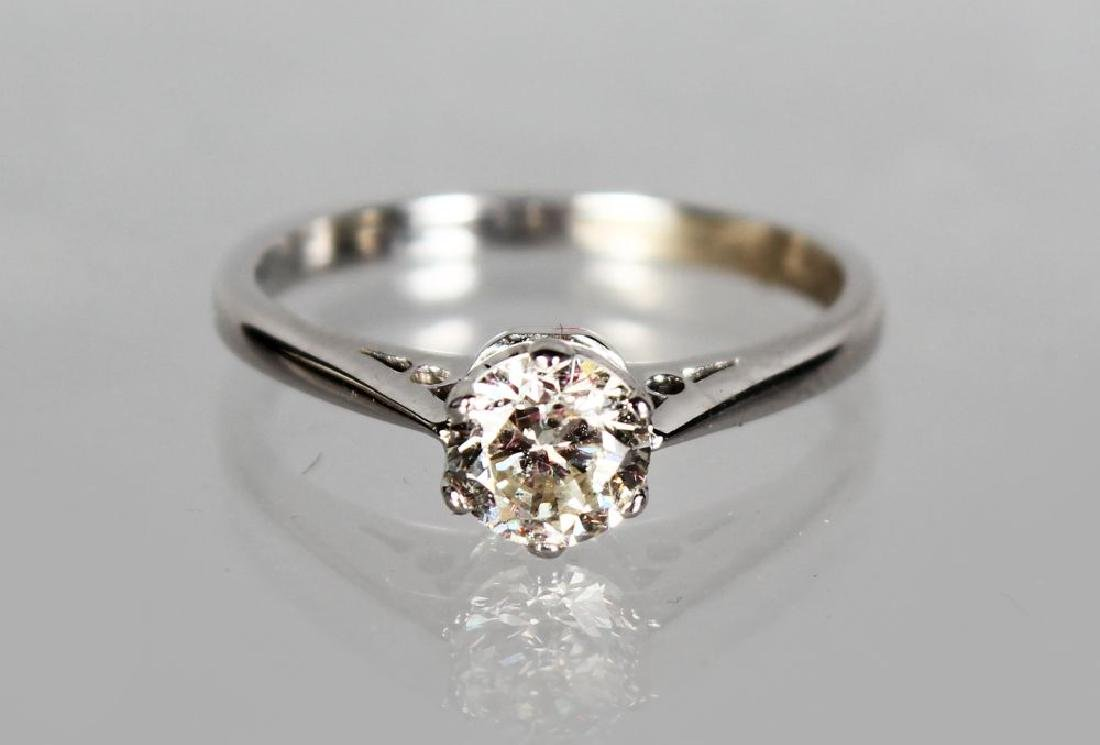 AN 18CT WHITE GOLD SOLITAIRE DIAMOND RING of 70 points,