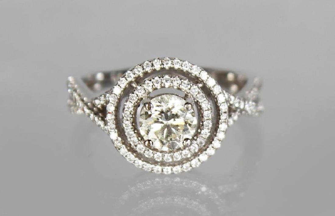 AN 18CT WHITE GOLD DIAMOND RING in the halo style,
