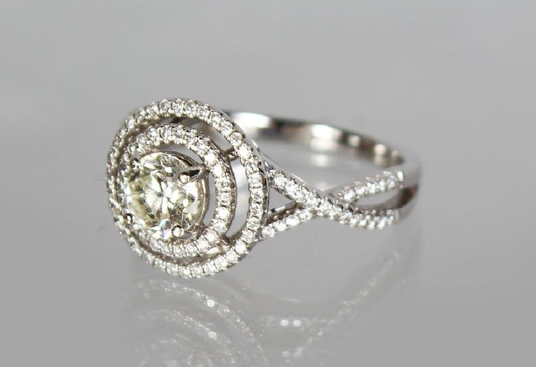 AN 18CT WHITE GOLD DIAMOND RING in the halo style, - 2