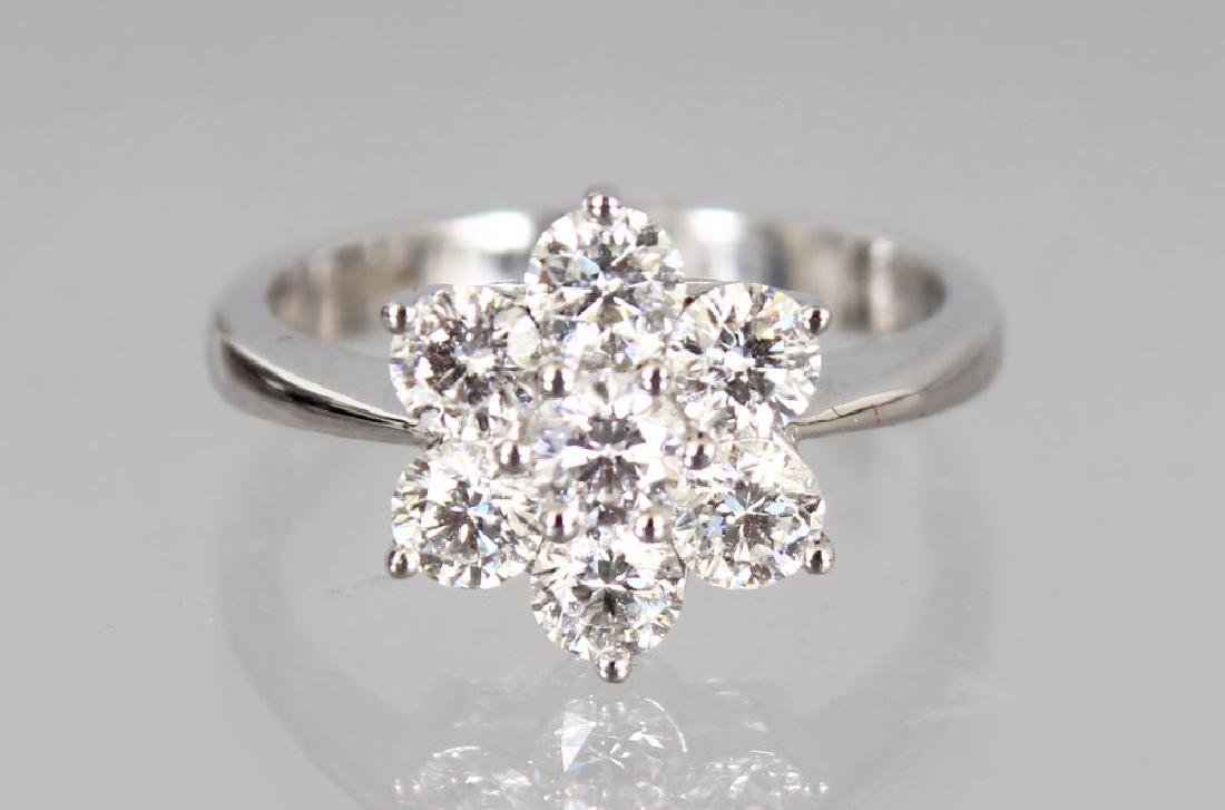 AN 18CT WHITE GOLD DAISY STYLE RING of 1.25cts, colour