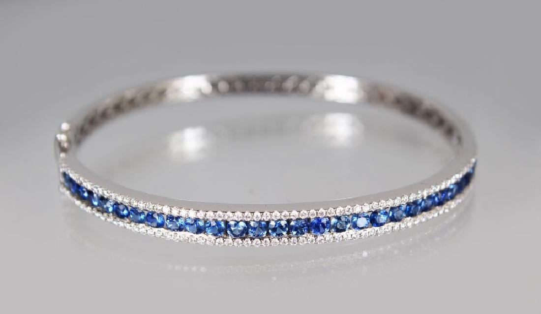 AN 18CT WHITE GOLD, DIAMOND AND SAPPHIRE BANGLE of