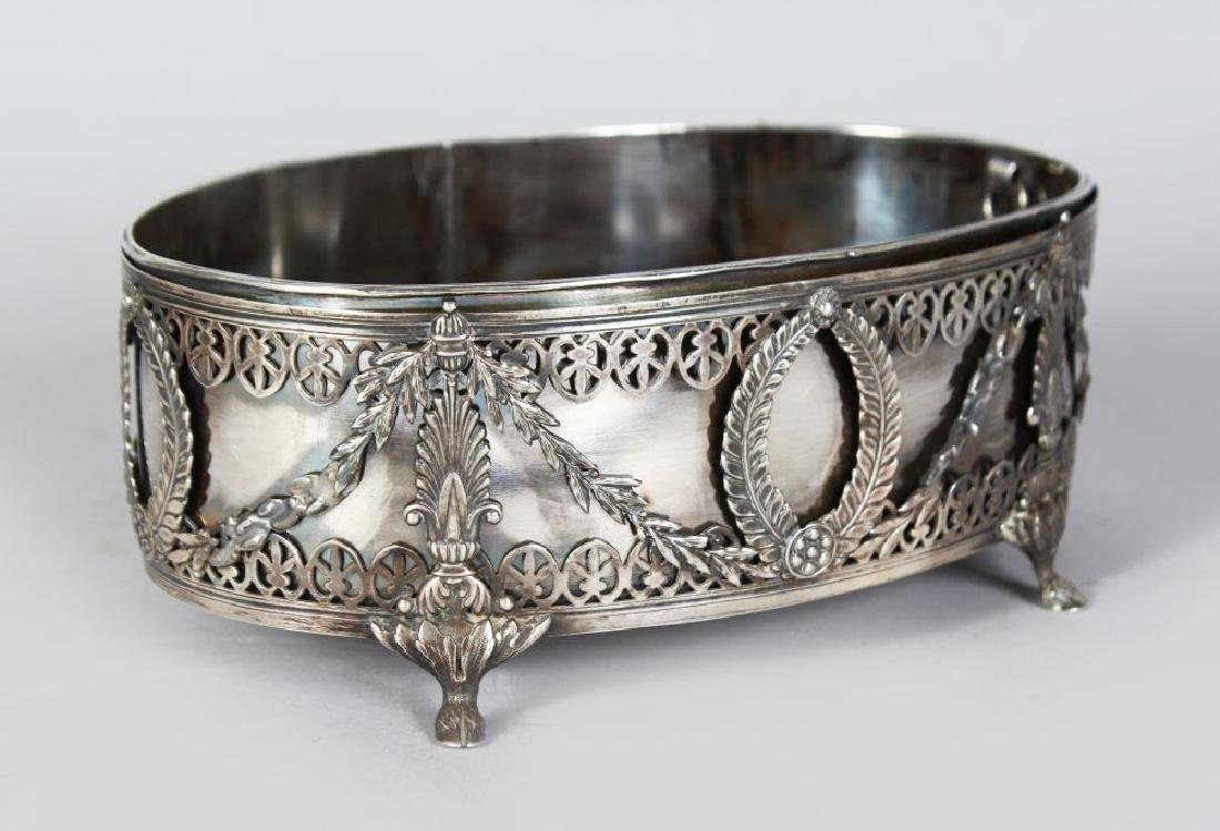 A SILVERN OVAL DISH AND LINER.  Alphonse Gobert