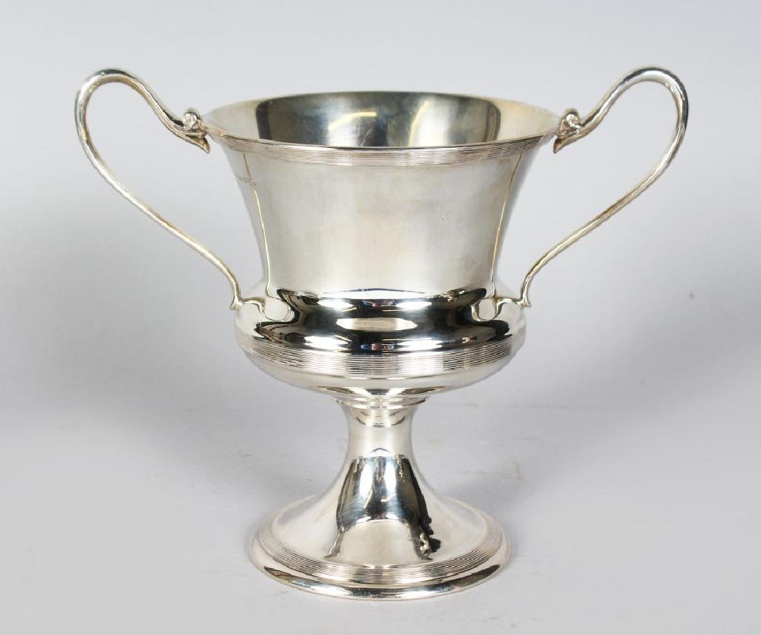 A TWO-HANDLED CHALICE CUP with reeded bands.  7.5ins