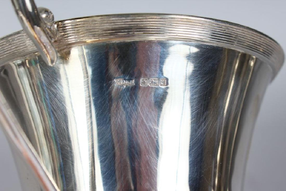 A TWO-HANDLED CHALICE CUP with reeded bands.  7.5ins - 2