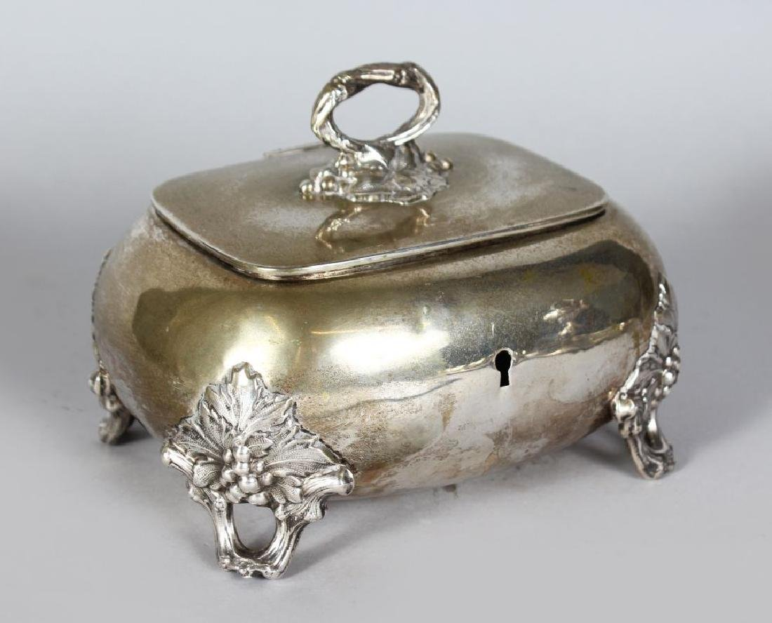 A CONTINENTAL SILVER .750 BOX AND COVER with fruiting