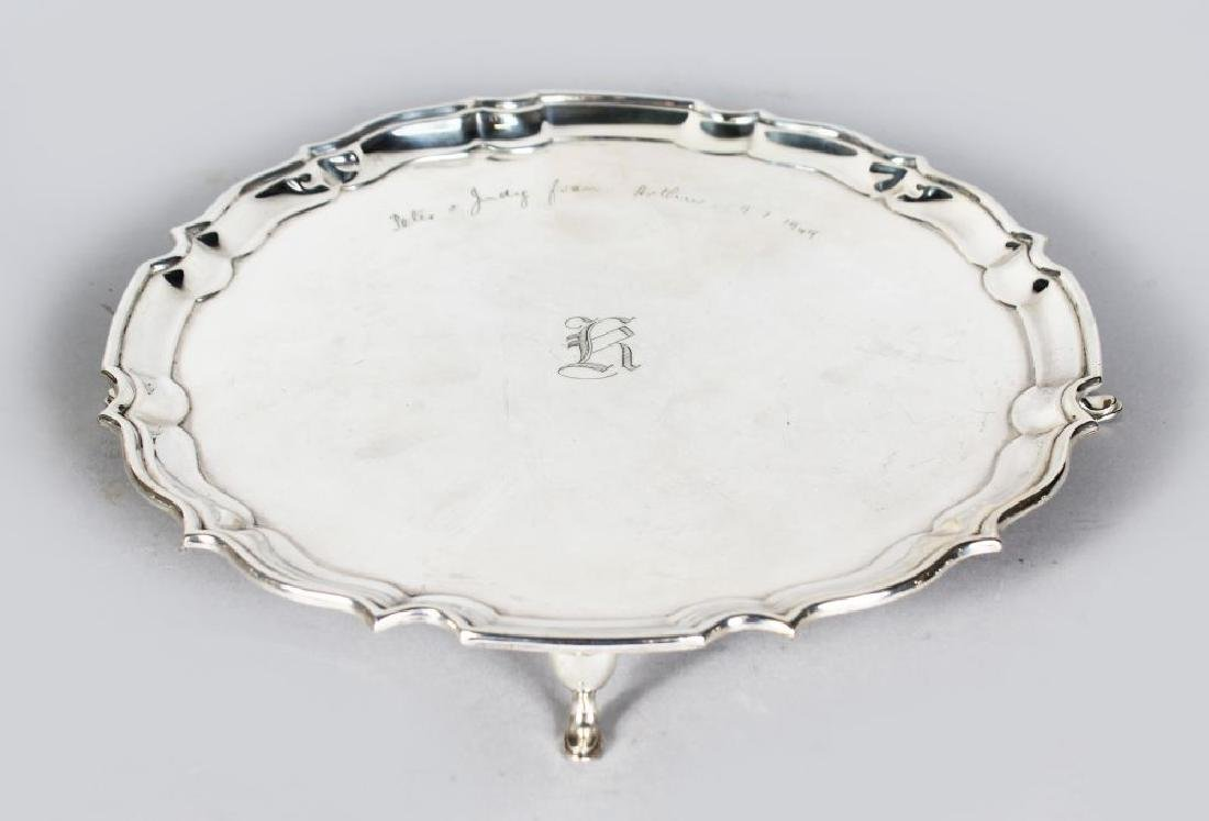 A PIE CRUST SALVER on four pad feet (Engraved