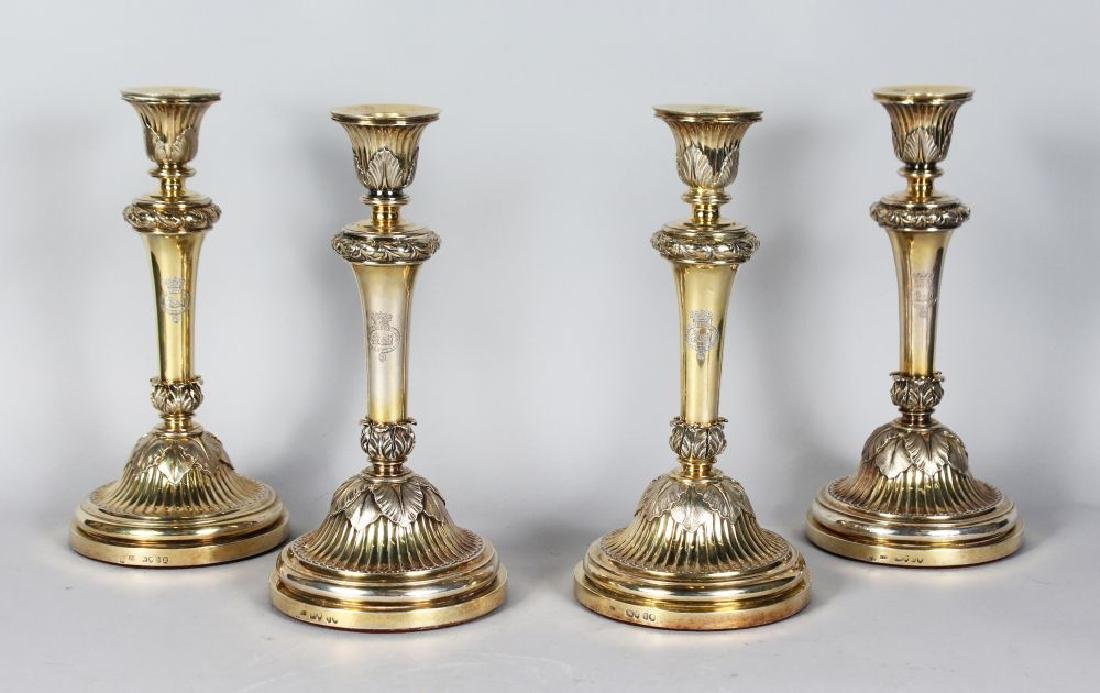 A VERY GOOD SET OF FOUR SILVER GILT CANDLESTICKS on