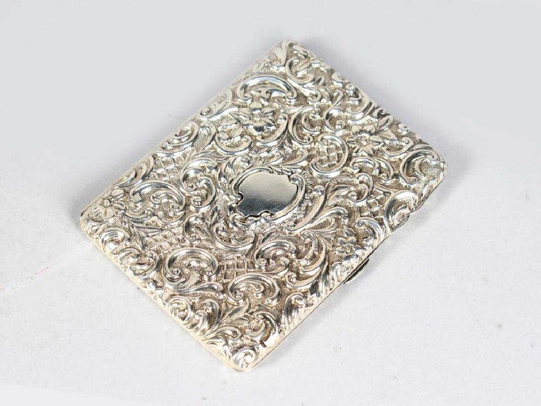 A VICTORIAN SILVER CIGARETTE CASE, with floral and