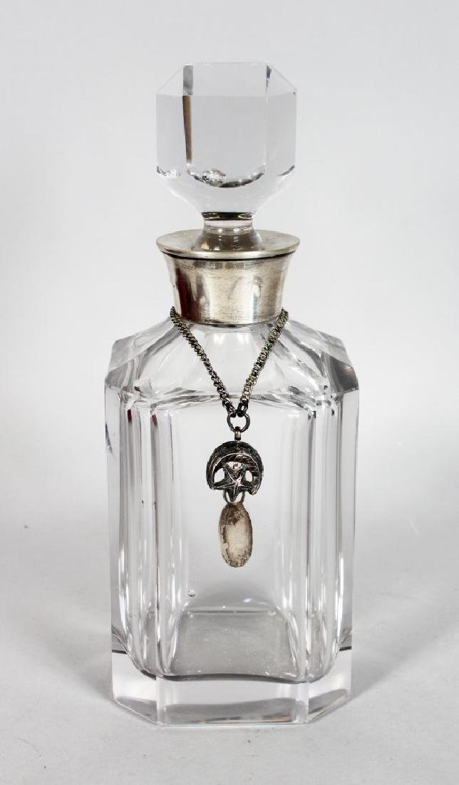 A SQUARE GLASS WHISKY DECANTER AND STOPPER with silver